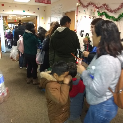 Line to our Winter Wonderland Holiday Item donation event for parents