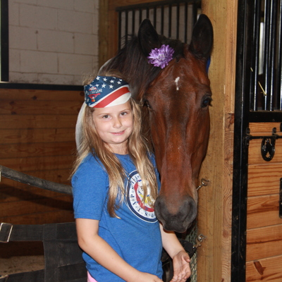 Gold Star / TAPS daughter with Iggy at our Warrior Herd camp
